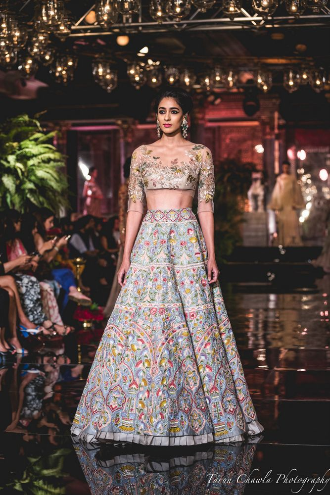 "All roads led to Taj Palace in New Delhi yesterday, half of which came to see Manish Malhotra's new bridal collection titled ""The Persian Story"" and half of which came to get a peek at Fawad Khan & Deepika Padukone...."