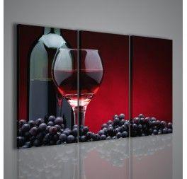 """Un quadro molto simile ad una """"natura morta moderna"""" per i soggetti che immortala: l'uva, una bottiglia di vino ed un bicchiere di vino su un fondo rosso scuro, quasi a voler indicare le fasi della trasformazione dell'uva. Una stampa su tela per enoteche e ristoranti."""