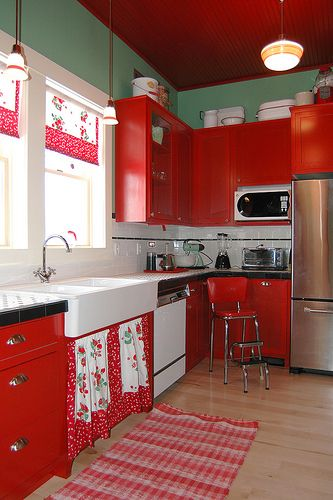 this has to be my kitchen now- I have the exact same chair and my cabs are red - just add the cherry fabric from the extras pile and accessorize to finish the look!! Now for cheap floor and counter top ideas.......