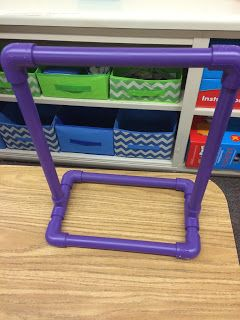 I use this table top PVC anchor chart stand to display guided reading objectives and anchor charts.