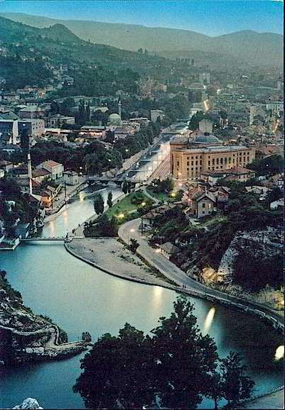 An aerial view of Sarajevo, the  the capital[8] and largest city of Bosnia and Herzegovina. The city is surrounded by the Dinaric Alps and situated along the Miljacka River in the heart of Southeastern Europe and the Balkans.