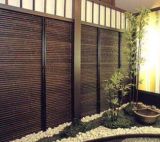 Black horizontal bamboo fence would dress up an ugly for Horizontal garden screening