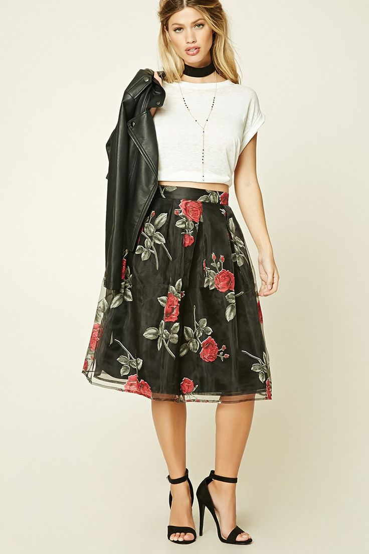 A woven skirt featuring a semi-sheer floral print overlayer, allover pleating, a woven underlayer, and an exposed back zipper.