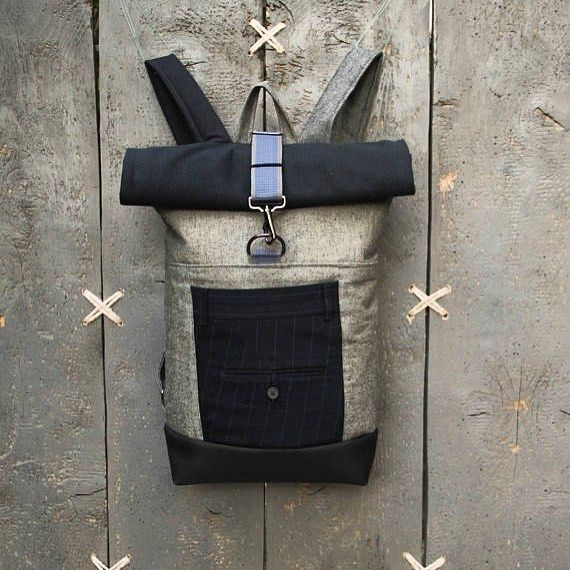 Mix of denim & canvas using parts from a blue striped men's trousers in this upcycled men's roll top rucksack, by 'Eating the Goober'