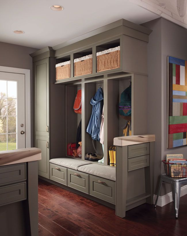 Garrison Square Maple in a duo of Sage and Mushroom finishes brings the look of other rooms into this comfortable and functional mudroom/entryway.