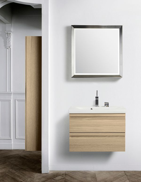 Oak vanity unit in combination with a modern framed mirror with handmade silverleaf.