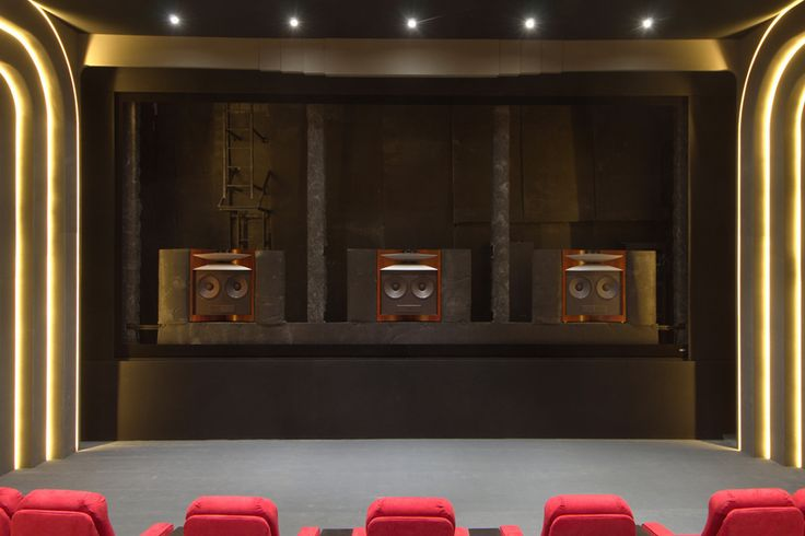 Home theater speakers placed behind acoustically transparent screen | CEDIA Luxury Home Theater Design | More at http://www.cedia.org/inspiration-gallery/the-show-must-go-on