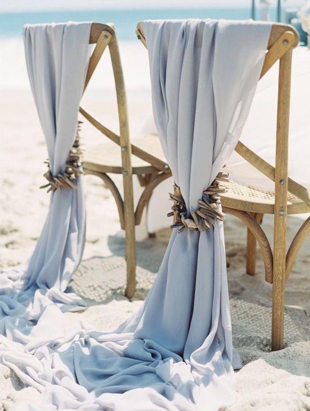 Oceanside wedding inspiration: Gorgeous chair decor.