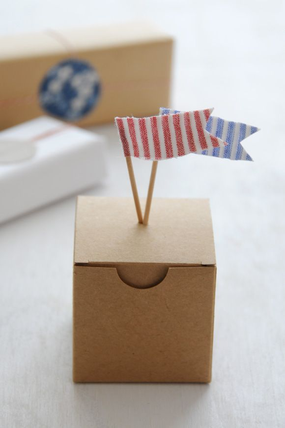 Little flags as gift toppers.