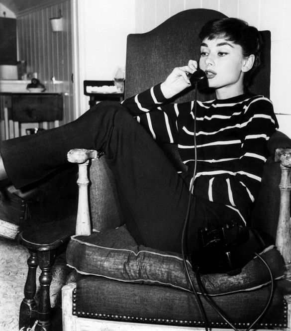 Style icon Audrey Hepburn in a classic black and white stripe sweater.