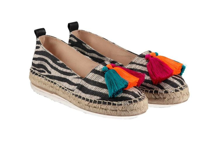 Zebra Print Fabric Zebra Print Fabric Upper Multi coloured tassels Leather lining & insock Super comfy memory foam cushioning Traditional Jute espadrille sole Flexible man made outsole Made in Spain Traditional handsewn espadrilles tend to feel snug at first but stretch with wear. If you're unsure about the size please test with indoor use only.  Look after your shoes - Espadrilles are a Summer shoe so we recommend avoiding wet and muddy conditions. Enjoy them on sunny Summer days...