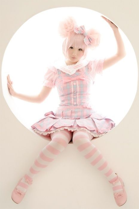 living 'doll' Harajuku doll.  Pale pink stripe tights.  Pink and gray plaid school girl dress. Japanese style