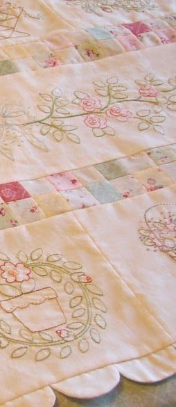 From little acorns: … a lovely mix of embroidery and small squares. With a delightful scolloped edge.