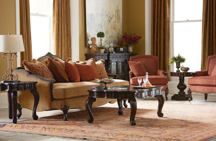 Wood Trim And Golden Bronze Upholstery Are The Stars Of The Sofa In The La  Bella
