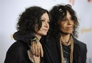 """View PhotoActress Sara Gilbert (L) and musician Linda Perry arrive at the GLAAD Media Awards …LOS ANGELES (Reuters) - Sara Gilbert, host of female chat show """"The Talk,"""" announced on Monday that she is engaged to her singer-songwriter Linda Perry.Gilbert, 38, who starred as rebellious daughter Darlen"""