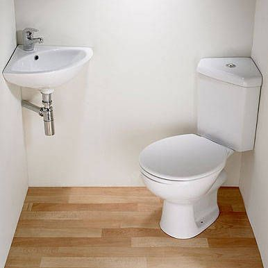 Crazy small bathroom solution: corner sink, corner toilet. Source for the post: Click