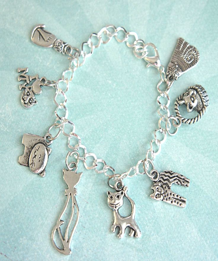 this charm bracelet features cat lover inspired tibetan silver charms -a silver plated zinc alloy metal which is lead and nickel free. each charm is attached to a silver tone bracelet that measures 7.