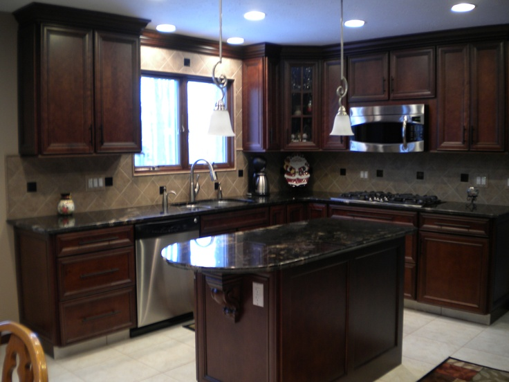 Custom cabinetry and tile backsplash with granite counter