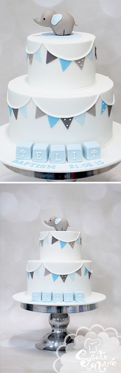Eli's baptism cake featured bunting, baby blocks, and an adorable sugar elephant! The inside was white chocolate mud cake a with vanilla buttercream filling.  Love this clean, modern take on a traditional celebration cake. | Made by Sweet by Nature, Melbourne VIC