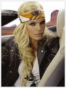 Leather jacket, fishtail braid, head scarf
