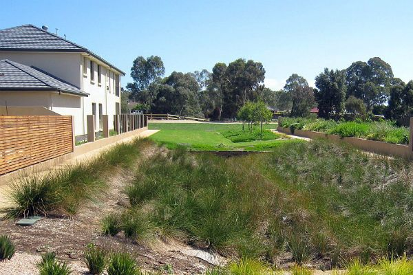 Vegetated swale at Underdale. Water sensitive urban design promotes the sustainable use and re use of water in urban development and buildings.  http://www.naturalresources.sa.gov.au/adelaidemtloftyranges/water/managing-water/water-sensitive-urban-design