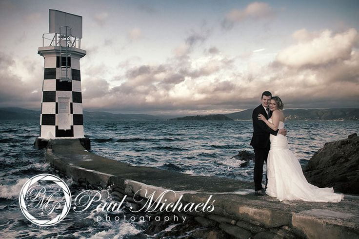 The bride and groom at Halswell point lighthouse. Wellington weddings by PaulMichaels photography http://www.paulmichaels.co.nz/bede-dawn-wedding/