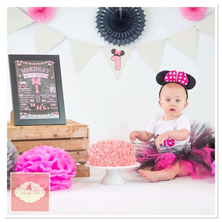 Celebrating her 1st birthday in her Minnie Mouse set