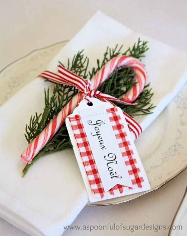 a simple table setting using a candy cane, evergreen bough  and a gift tag