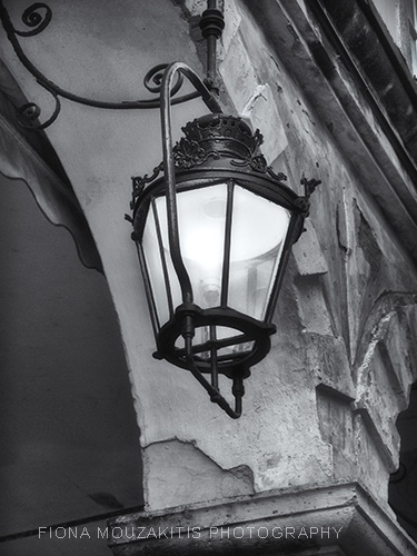 SHINE. One of the famous light lanterns of the Liston. Corfu Greece.