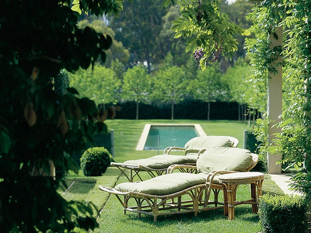 "People using the pool have the choice of sunbathing beside it or on the grass in front of the pavillion – or they can escape to the shade of the plane trees (Platanus orientalis) planted on three sides of the swimming-pool garden.    from ""The Enchanted Garden"" by Paul Bangay"