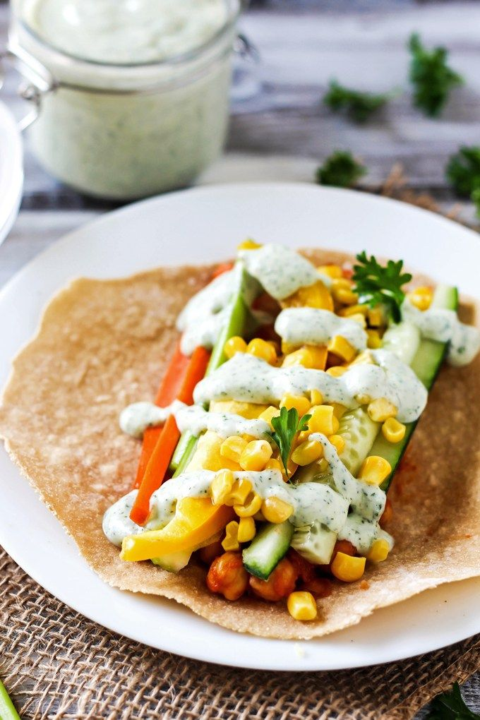 A smoky, savory Vegan BBQ Chickpea Wrap is the perfect lunch to pack for work or school! Stuff it with fresh vegetables for a healthy, satisfying meal.