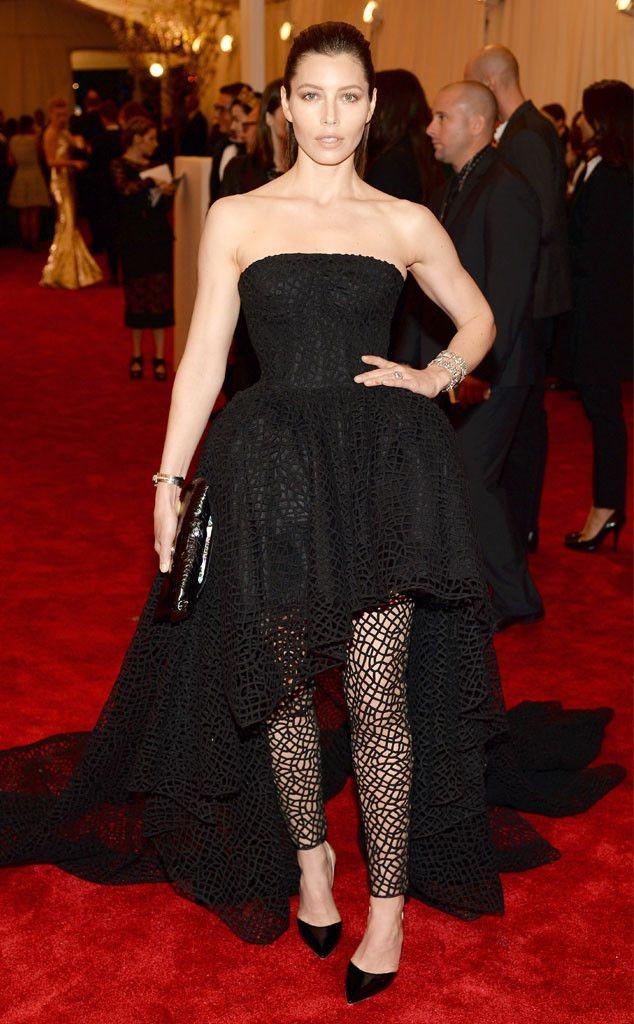Jessica Biel dons a black Giambattista Valli gown and fishnet leggings.