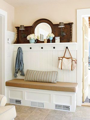 Mudroom made beautiful!  This room offers function and style.  Tuck away last season's coats and shoes in the storage bench.  Symmetry makes this work, with the sconces and hooks.    Ok. This thing could be something we do by the back door in that giant room, where the short bench already is.