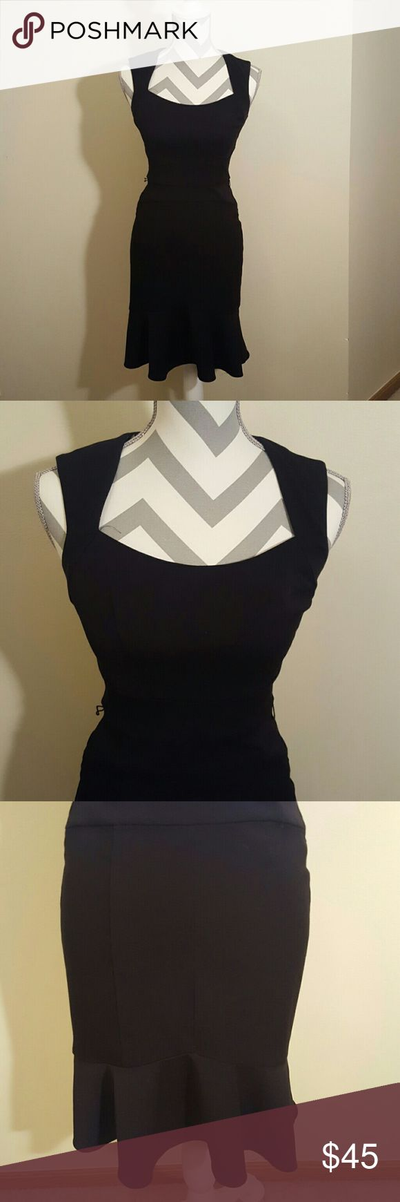 White House Black Market Trumpet Dot Shift Dress White house black market brand in a size 00. This dress is stunning! It is black with a black+white polka dot satin feeling lining. It has small belt loops (belt not included), a mermaid/Trumpet bottom, and back zipper. Pictures do not do this beauty justice! Smoke free home and fast shipping. Thank you for checking out my closet. White House Black Market Dresses