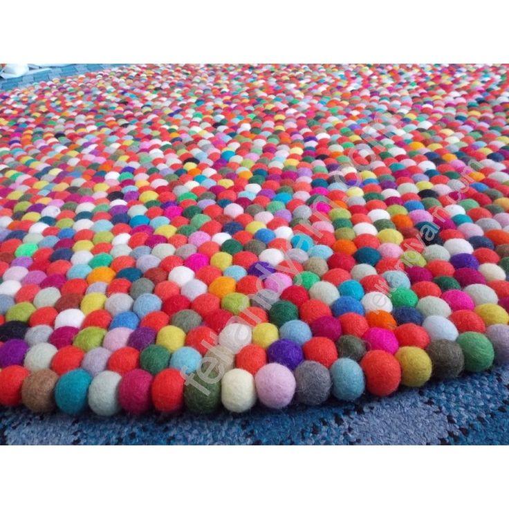 Red color based Multi colored felt ball rug in 140 Cm diameter. Completely handmade in Nepal.