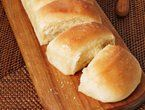 PARKER HOUSE ROLLS: ~ Recipe Courtesy of Bobby Flay; Show: Boy Meets Grill. Prep Time: 20 min; Inactive Time: 2 hr; Cooking Time: 25 Min; Servings: About (24) Rolls.
