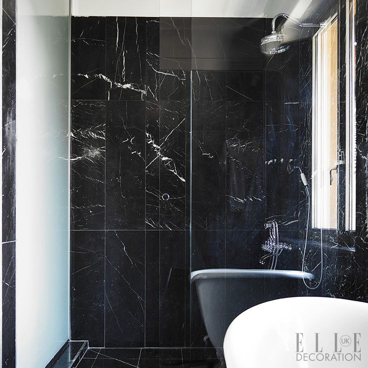 Black is a stylish alternative to white in a bathroom, and looks especially dramatic in a material such as marble, which clads the floor and...