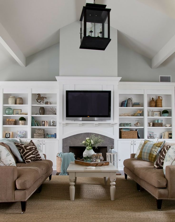 Beautifully layered bookshelves and living room.  The layers of fabric, patterns and textures is simply amazing.    Sherry Hart Designs -Design Indulgence.