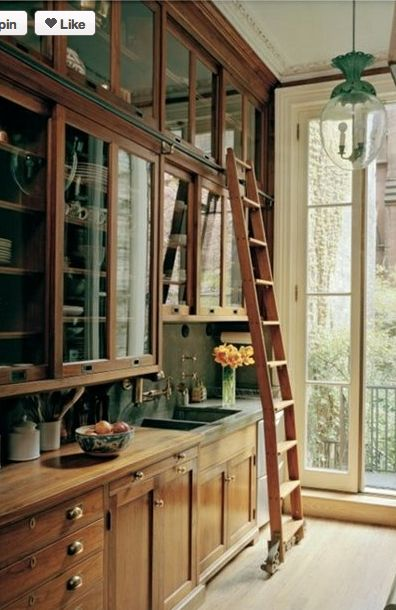 wow! Ladder, tall ceilings, wood, beautiful doors,…