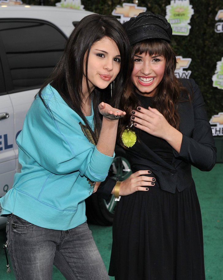 Pin for Later: Celebrate Selena Gomez's 24th Birthday With a Look Back at Her Stunning Evolution February 2008 A young Selena and Demi Lovato posed together at a Chevy event in LA.