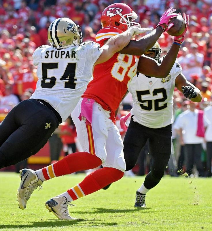 Saints vs. Chiefs  -  27-21, Chiefs  -  October 23, 2016:   Kansas City Chiefs tight end Demetrius Harris grabs a first down pass under pressure from New Orleans Saints inside linebacker Nate Stupar in the second quarter during Sunday's football game on October 23, 2016 at Arrowhead Stadium in Kansas City, Mo.