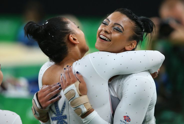 Ellie Downie of Great Britain hugs her sister Becky Downie after completing the vault during the Women's Team Final