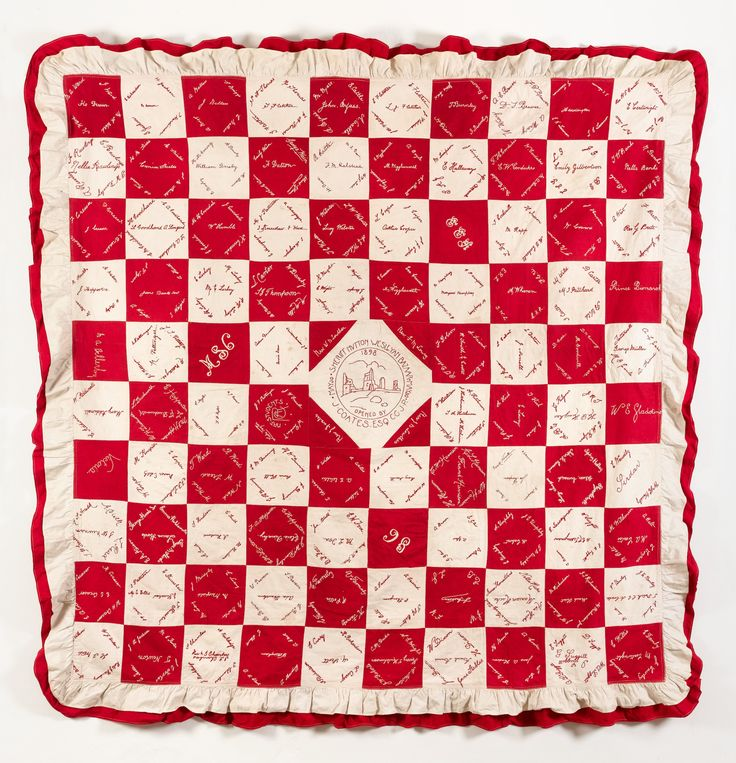Sheriff Hutton Bazaar Coverlet.  Maker:Sheriff Hutton Wesleyan Church Date:1898  Turkey Red twill and white cotton square patchwork signature quilt, with alternating red and white squares around a central embroidered white patch set on point. An image of Sheriff Hutton Castle is embroidered in red thread in the central square, with the embroidered text 'Sheriff Hutton Wesleyan Bazaar May 30 1898 Opened by J Coates Esq. C.C J.P.'