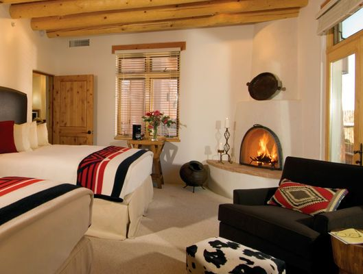 white hot southwestern decor and cozy fireplace at Bishop Lodge Ranch Resort & Spa | #travelocity #hotel #newmexico #ranch