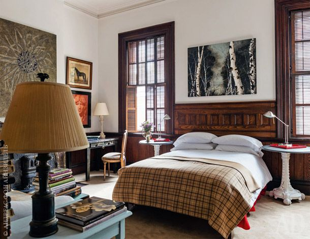 """Guest bedroom. Bedside tables are made from old lampposts. Above the bed picture Frank Faulkner in a series of """"Birches""""."""