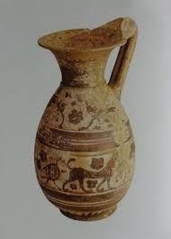 OLPE- caraffa che serviva per versare il vino, una sola ansa verticale, piede ampio, collo e becco, di ceramica al tornio, arte arcaica, Grecia