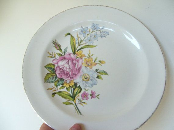 9.25 diameter china plate with gorgeous floral display. Marked Century by Salem Made in USA Warranted 23 karat.  This plate is in lovely but