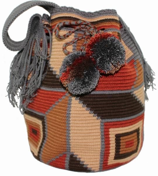 Each PUTCHIPUU Bag is handmade by the women of the WAYUU Tribe located in the northern peninsula of Colombia in a rural area called La Guajira. One bag can take up to 25 days to make and the design is