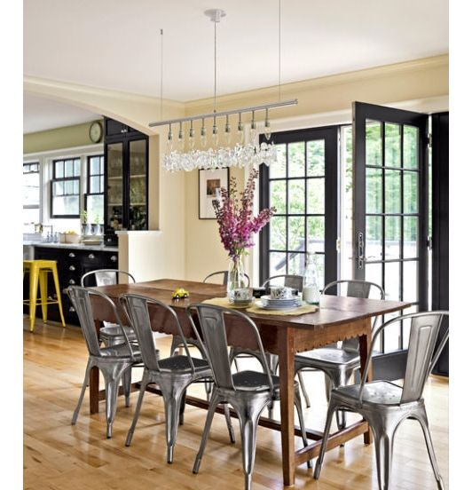 Rustic And Modern Dining Room With Shiny Steel Cafe Chairs