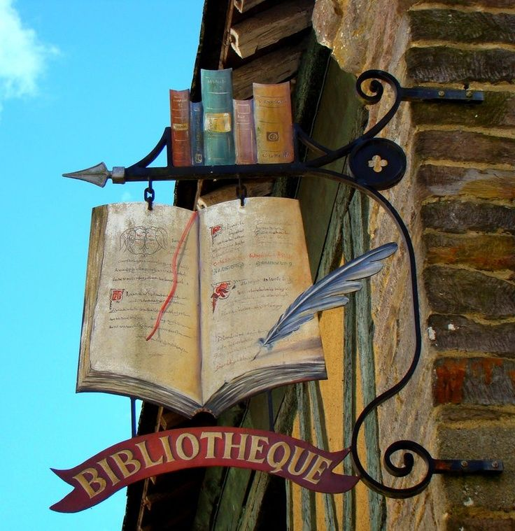 Book Sign. If I had a bookstore, this would be my ideal store sign. Whimsical, clever and old charm classic.